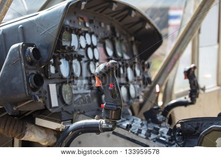 twin helicopter flight control in cockpit with instrument panel background