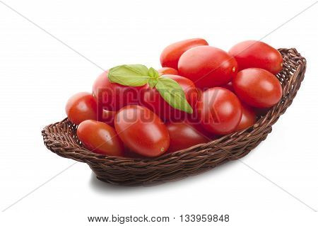 Group of tomato and basil leaves on wood table