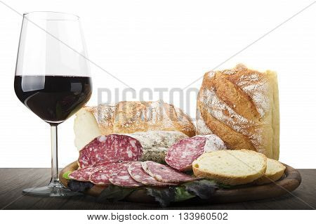 wooden cutting board with salami and glass of Red wine