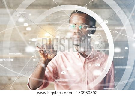 Portrait Of African Man In Glasses, Using Digital Device, Pointing At Icons On Futuristic Screen Int