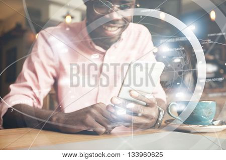 Happy Smiling Successful African Entrepreneur Holding Futuristic Mobile Phone, Messaging His Family