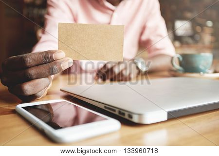 Business And Career Concept. Close Up Shot Of African Corporate Worker Showing Blank Parchment Card