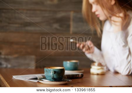 Young Girl In Office Clothes Checking Out Her Social Networks In A Stylish Café, Typing On Devi