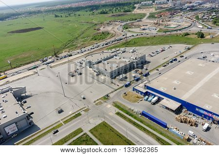 Tyumen, Russia - May 27, 2016: Aerial view onto trading centers and road construction on Fedyuninskogo and Melnikayte streets intersectiob