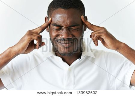 Headshot Of Dark-skinned Man Having Bad Headache, Pressing Fingers Against His Temples, Suffering Fr