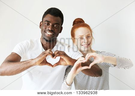 Happy Youngsters Showing Love Signs With Their Hands Cupped In Heart Shape. Afro American Man Smilin
