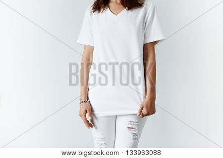 Attractive Young Woman In Blank White T-shirt With Copy Space For Your Text Or Advertising Content.