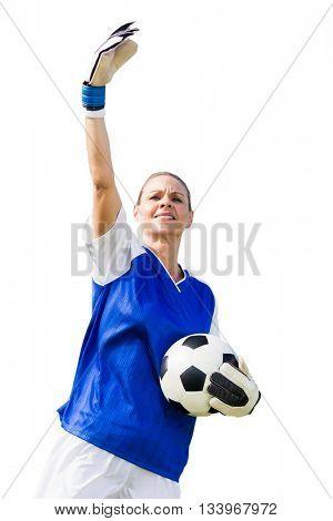 Woman goalkeeper raising an arm on white bakground