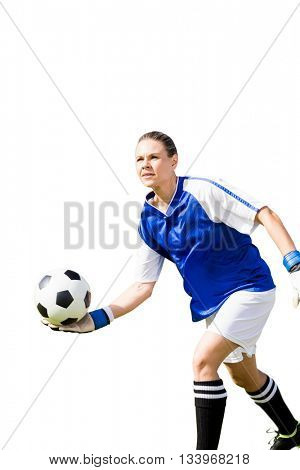 Woman goalkeeper throwing again the ball on a white background
