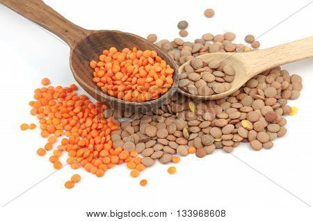 lentils wooden spoons isolated on a white