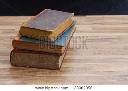 Antique Books stack on wooden table background