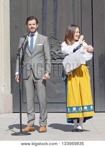 STOCKHOLM SWEDEN - JUN 06 2016: The swedish prince Carl Philip Bernadotte and princess Sofia Hellqvist holding the newborn baby Alexander in front of the royal castle during the swedish National day