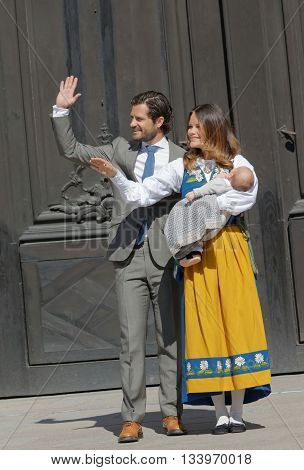 STOCKHOLM SWEDEN - JUN 06 2016: The swedish price Carl Philip Bernadotte and princess Sofia Hellqvist smiling and waiving to the audience holding the newborn baby Alexander