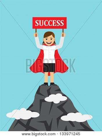 happy businesswoman in a raincoat superhero standing on the mountain top and holding a sign with the word