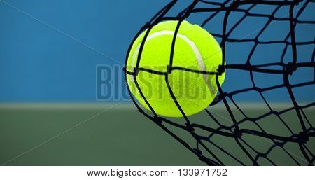 Tennis ball with a syringe against digitally generated image of bi colored background
