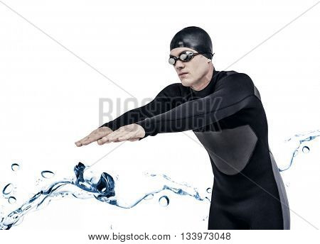 Swimmer in wetsuit while diving against water bubbling on white surface