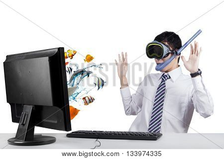 Suprised businessman looking at fishes on the monitor while wearing goggles and snorkel isolated on white background