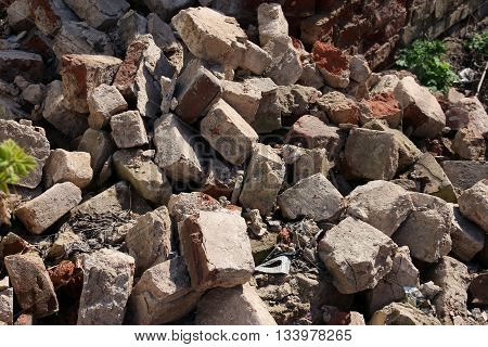 A pile of debris and broken old red bricks
