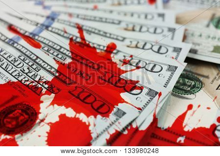 Many hundred dollars cash money with bloodstains