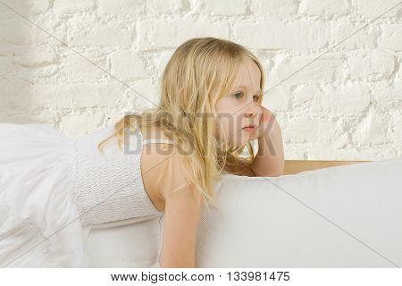 Child girl dreaming home in light bakground