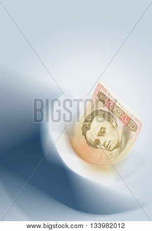 Ukrainian Hryvnia abstract background. Banknote in blurred abstract flowing vortex. Low aperture shot focus on Shevchenko`s eyes