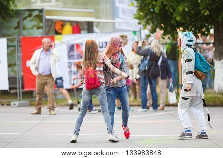Kaliningrad Russia - June 12 2016: Young people joyfully celebrate The Festival of Paints during the Day of Russia