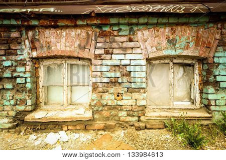 Two Old Windows And Bricks