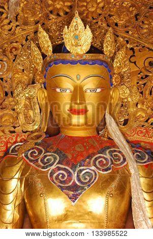 GYANTSE, TIBET, CHINA - AUGUST 4, 2010 - statue of Buddha at Pelkor Chode Monastery (Palcho Monastery)