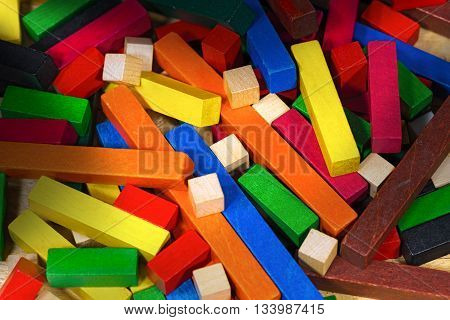 Close up of a toy with colorful pieces of wood for creative exercises and mathematical reasoning