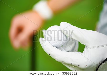 Today is his day. Close up of golf player hand holding ball on his hand