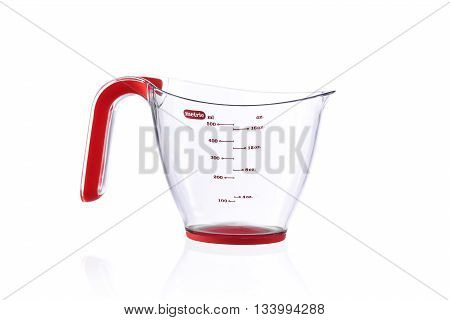 Modern metric measuring cup isolated on white background