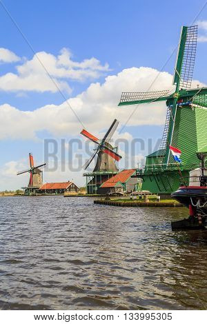 ZAANSE-SCHANS, NETHERLANDS - MAY 9, 2013: There're windmills which located in the area of North Holland.