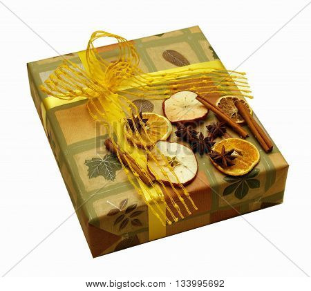 Luxury packed present decorated with dry apple, orange and cinnamon pieces