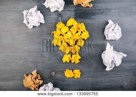 Idea concept with crumpled paper on dark wooden desktop