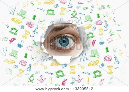 Education concept with blue eye looking through hole with educational icons