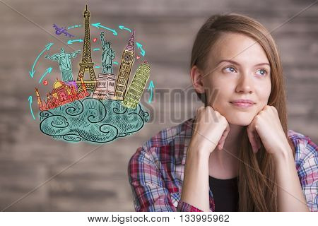 Portrait of thoughtful young woman daydreaming about holidays. Concept of travel