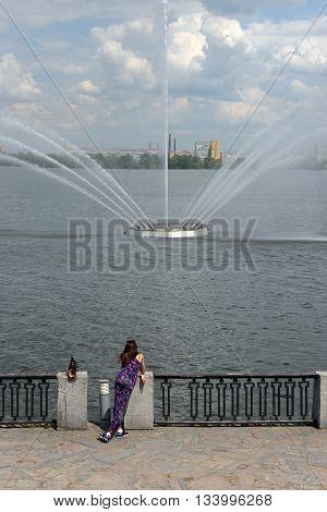 Woman Is Standing On Embankment Near Floating Fountain, Dnepropetrovsk, Ukraine.