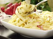 pic of italian food  - italian pasta with bacon and parsley on decorated table - JPG