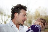 father joking with baby girl