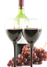 stock photo of wine grapes  - glasses with red wine and grapes - JPG