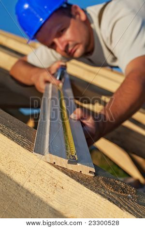 Builder Carpenter Measuring Wood Planck
