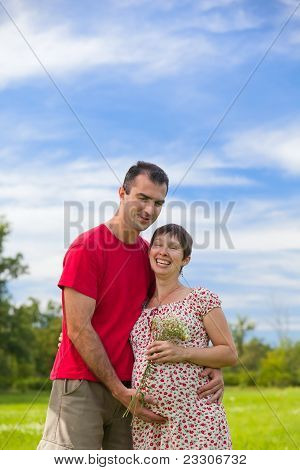Husband Hugs His Pregnant Wife