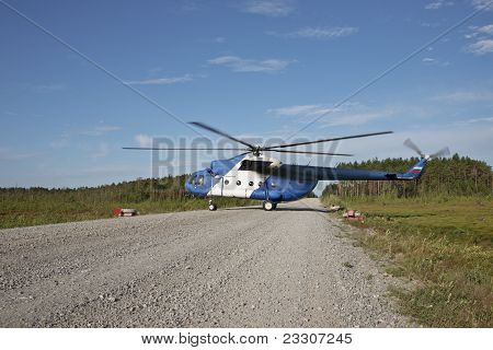 Work Of Helicopters On Deposits In Western Siberia