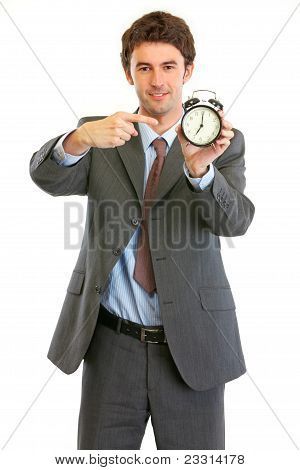 Modern Businessman Pointing On Alarm Clock