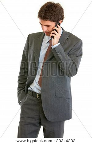 Concerned Businessman Talking On Phone