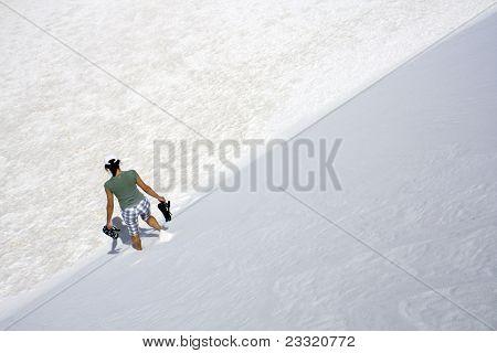 Girl Walking Down The Dune