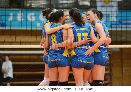 KAPOSVAR, HUNGARY - APRIL 24: Kaposvar players celebrate at the Hungarian NB I. League woman volleyball game Kaposvar (blue) vs Ujbuda (black), April 24, 2011 in Kaposvar, Hungary.