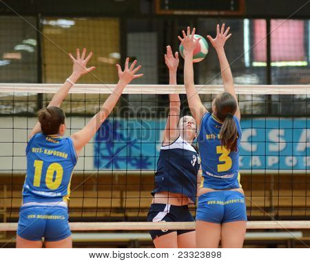 KAPOSVAR, HUNGARY - APRIL 24: Szandra Szombathelyi (blue 10) in action at the Hungarian NB I. League woman volleyball game Kaposvar (blue) vs Ujbuda (black), April 24, 2011 in Kaposvar, Hungary.