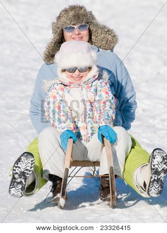 Winter, snow, sun and fun - Sledding at winter time