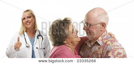 Senior Couple with Medical Doctor or Nurse with Thumbs Up Behind.